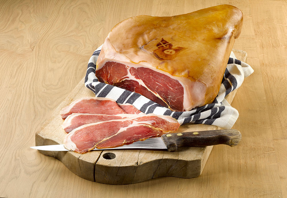 Rougeot du Charvin® Savoie cured ham sliced on a chopping board