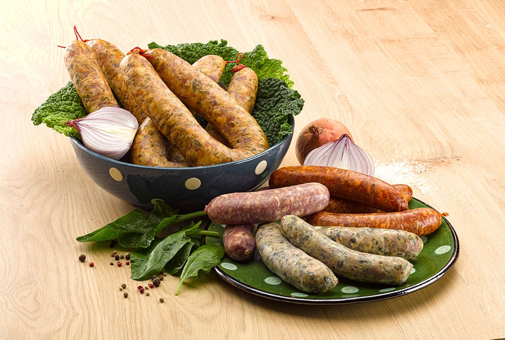 Bowl and plate of diots, pormoniers, cabbage sausages